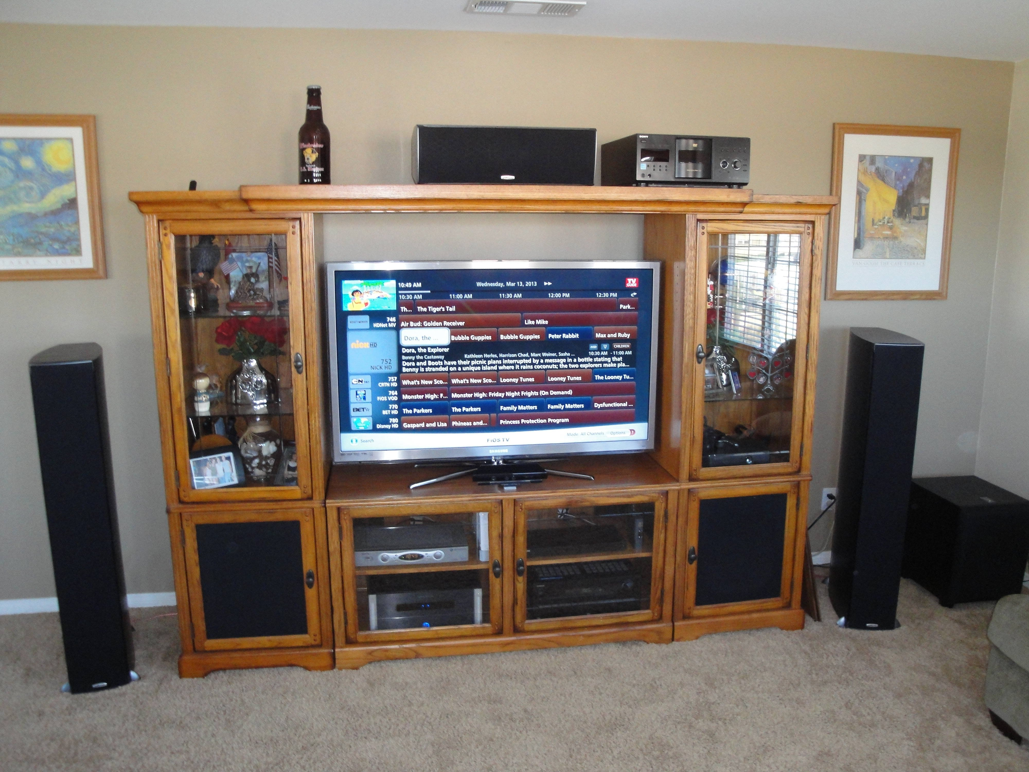 next step is to get a custom salamander designs tv stand and mount the tv on the wall then the center can go right below it where it belongs