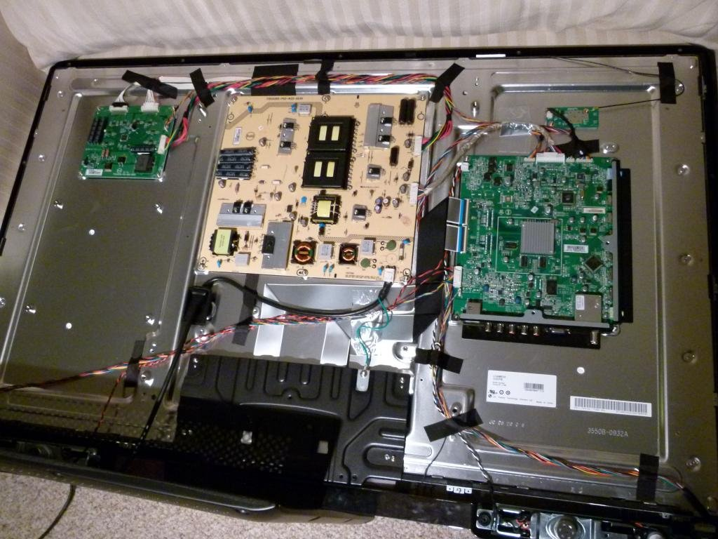 lg tv main board. this is the main board that needed repair, connectors all have latches, wires are tight with very little play in them and also quite thin, lg tv