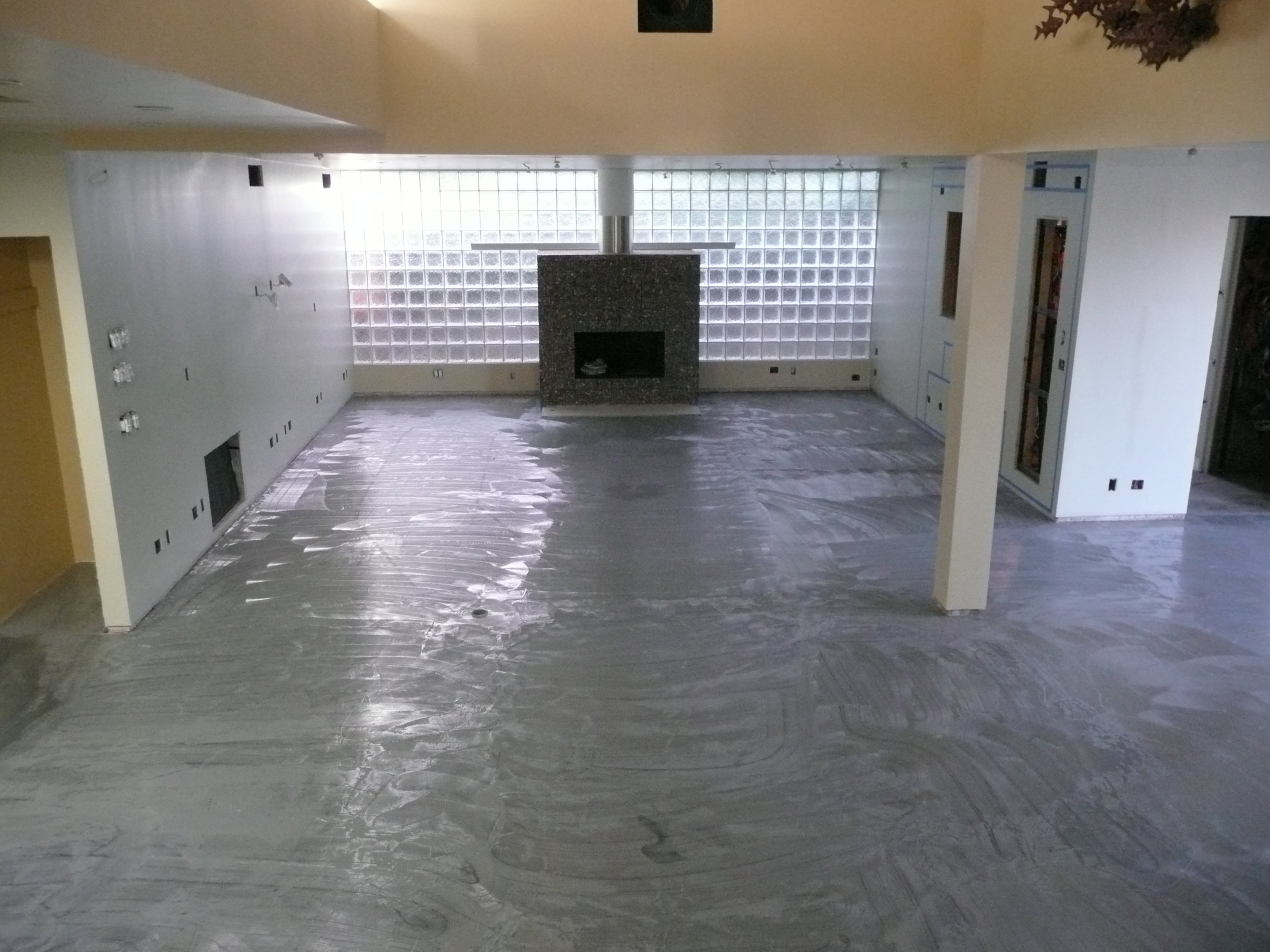 "Theater construction - reflective: slab/maple floors, glass block wall, stone fireplace, drywall on 3/4"" ply Walls soundproofed with 3.5"" solid foam and 1/4"" acoustical rubber. Ceilings soundproofed with 6"" solid foam, 6"" fiberglass, 1.5"" ply, 3"" solid foam"
