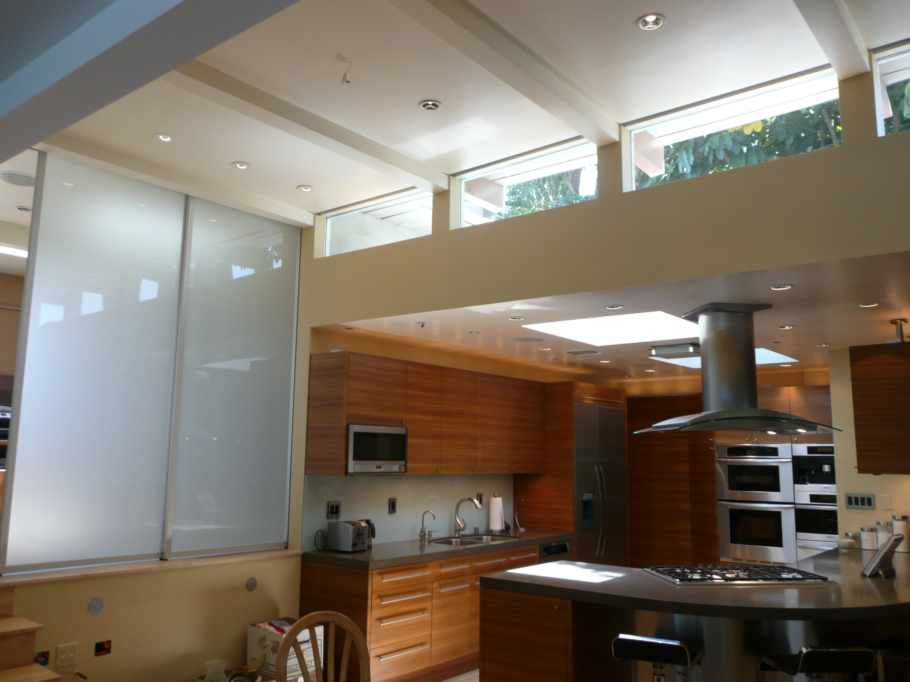 14 ft ceilings open kitchen area and open loft den area Windows have recessed pockets shades for day viewing Glass sliders are usually recessed into wall opening to den area.