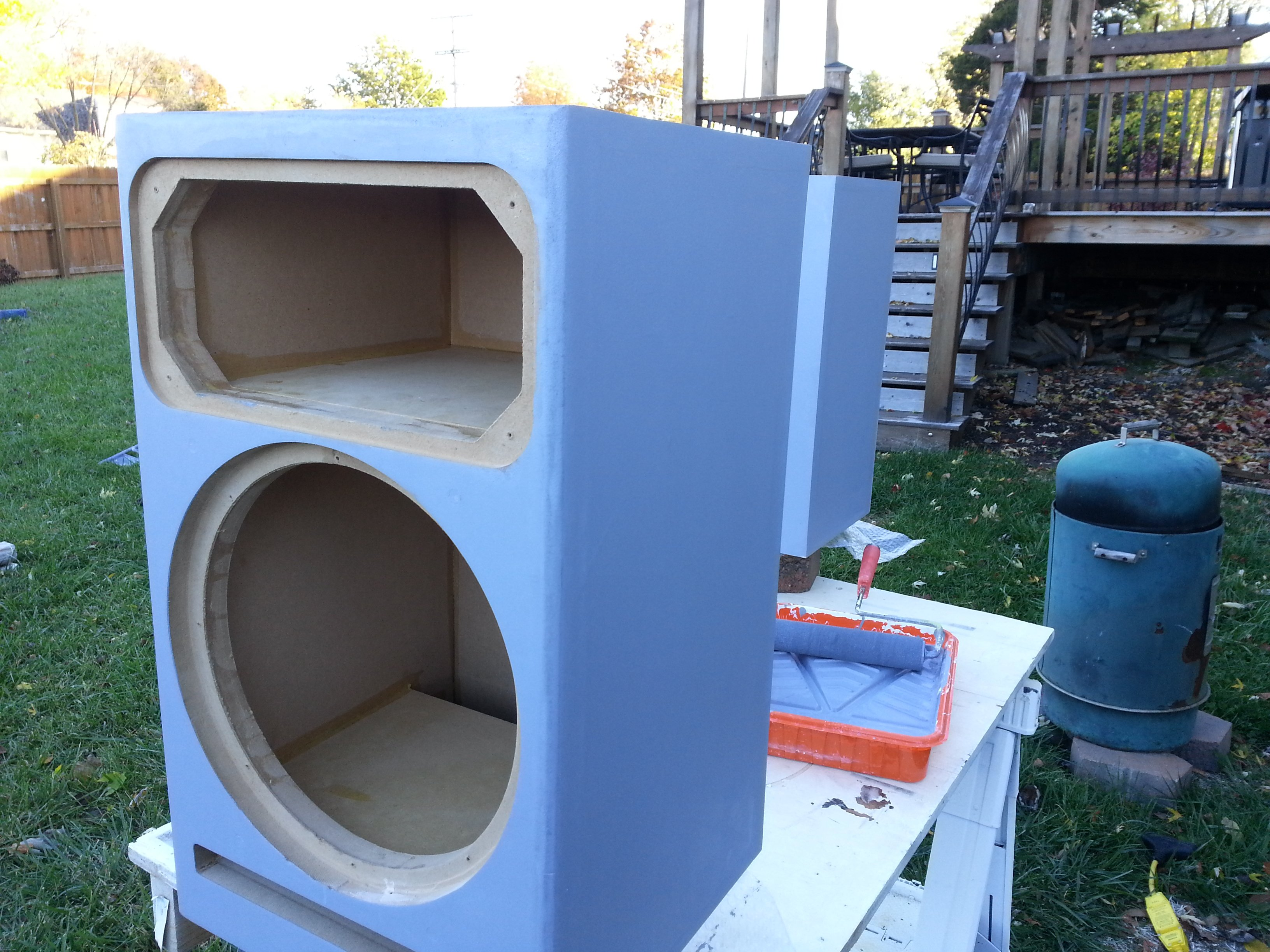 2 speakers and 2 subs = 1 gal. of Zinnser B-I-N sealer. I rolled the sealer on the inside of the cabs too.