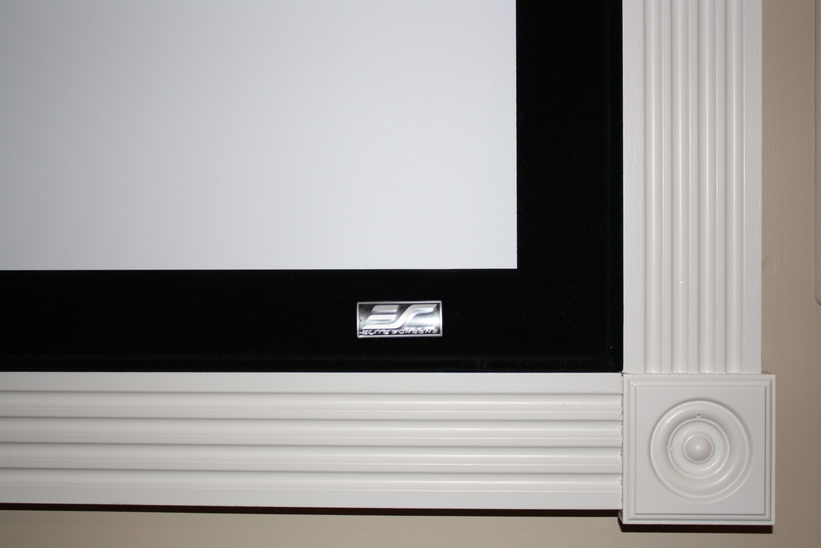 "100"" Elite (Sable) fixed mount screen. Fluted casing and Rosettes installed after mounting."