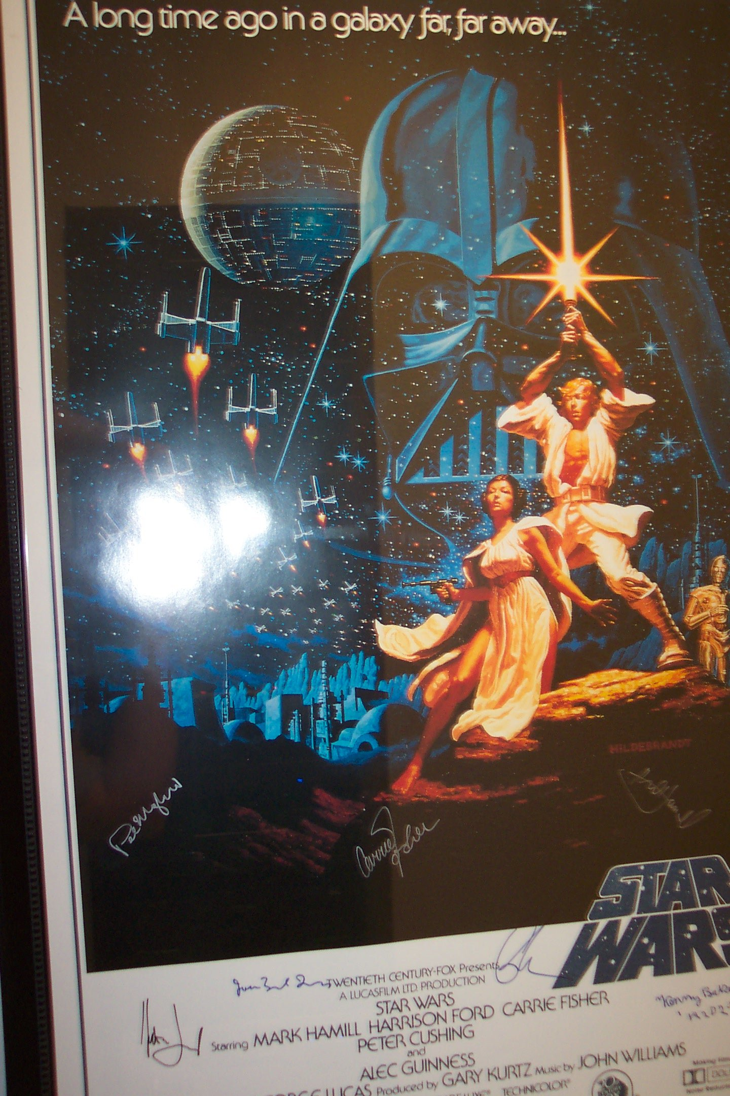 Autographed Star Wars poster - opposite gear rack in hall