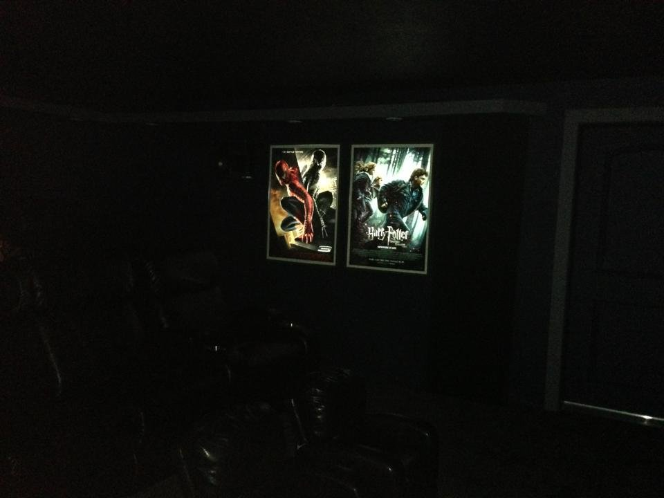 Custom DIY LED backlit movie posters on left side of theater: Spiderman 3 Harry Potter and the Deathly Hallows Part 1