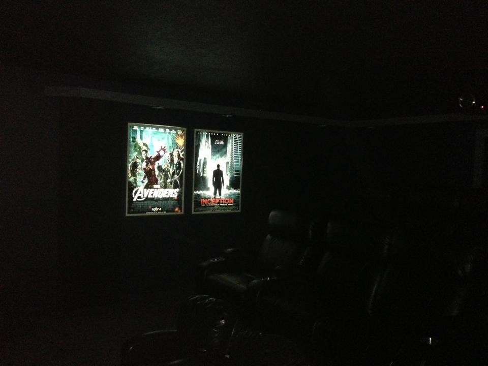 Custom DIY LED backlit movie posters on rightside of theater: Avengers Inception